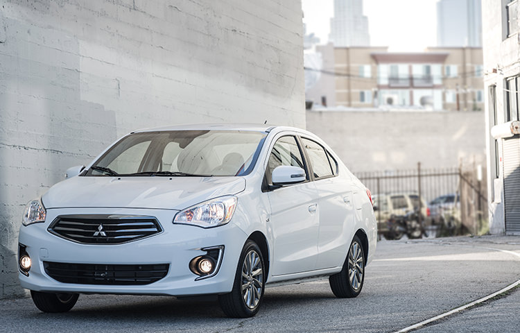 Mitsubishi Mirage G4 pearl white exterior parked against white wall