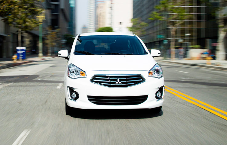 With incredible efficiency, be2017 Pearl White Mitsubishi Mirage G4 driving down street with visible interiorst-in-class legroom and more, the all-new Mirage G4 tackles small in a really big way.